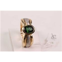 Ladies 14kt yellow and white gold ring set with oval faceted tourmaline gemstone and small accent di