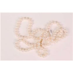 """Single strand of cultured saltwater hand knotted pearls, set with 14kt yellow gold clasp, 30"""" in len"""