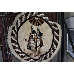 """Pierced round fur throw with full native figures and geometric border, 89"""" in diameter"""