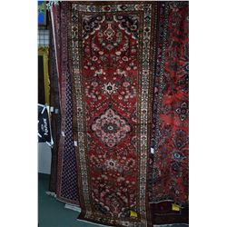 100% Iranian wool Lilihan carpet/runner with center medallion, overall floral pattern, red backgroun