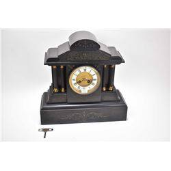 Antique slate chiming mantle clock with porcelain Roman numeral dial and Corinthian column decoratio