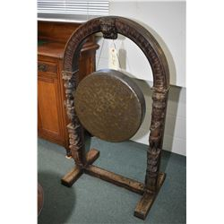 Floor standing, hand hammered bronze gong in hand carved oak frame