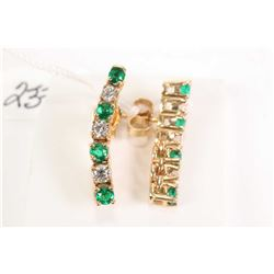 Pair of 14kt yellow gold emerald gemstone and diamond earrings. Set with .24cts of round full cut di