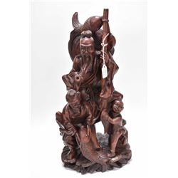 "Antique hand carved rosewood fishermen with their catch, 16"" in height, in age appropriate condition"