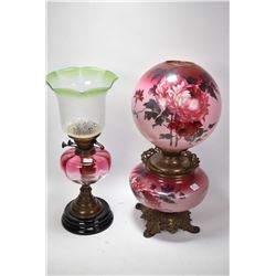 Two vintage oil lamps including floral banquet lamp with cast base and transferware font and shade p