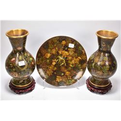 "Three pieces of matching cloisonne including two 10"" vases on wooden plinths and a 10"" diameter wood"