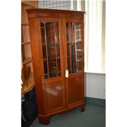 "Antique mahogany two door corner cabinet with glazed upper display panels and storage in base 75"" in"
