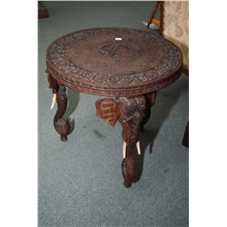 Heavily carved east Asian elephant motif three legged occasional table, note one leg missing an ear