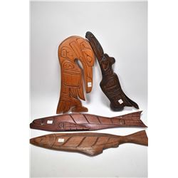 Selection of Haida wooden carvings including Raven by artist Cecil Wadhams, Alert Bay, B.C. Two salm