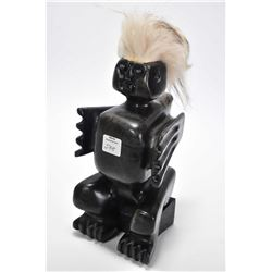 "Ojibwa ""Nanabush"" (spirit) soapstone carved figure, signed by artist Bart Lavalle and sitting on a r"