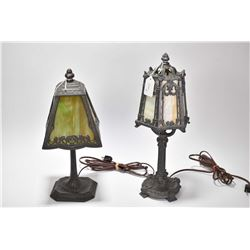 Two antique cast pewter table lamps with slag glass panelled shades