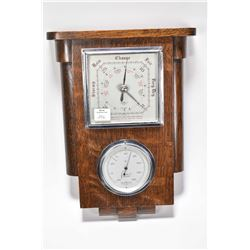 "Wall mount oak English made barometer and thermometer marked ""British made instrument, S.B"""