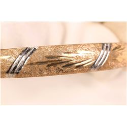 Ladies 10kt yellow gold bangle with diamond cut design. Retail replacement $600.00