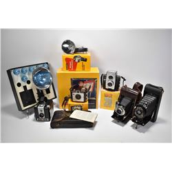 Selection of vintage and antique Kodak cameras including 6-16 bellows in leather case, 1A bellows in