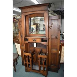 Antique oak hallstand with multiple single and double coat and hat hooks, stick/umbrella stand with