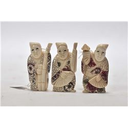 "Three carved ivory figures approximately 1 3/4"" in height"