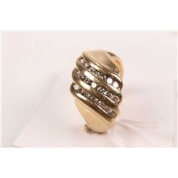14kt yellow gold and diamond ring set with 0.56cts of round white diamonds. Retail replacement value