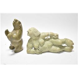 "Two carved green soapstone figures including reclining woman 9"" in length and an artist signed bear"