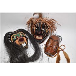 "Three carved masks, various artists including Sanford, W.'87, ""Wildman of the Jungle"" mask by"