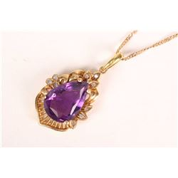 "Ladies 14kt yellow gold amethyst and diamond pendant on a 10kt yellow gold 16"" neck chain. Pendant s"