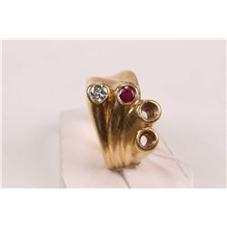 18kt yellow gold custom made ring set with .15ct white brilliant cut diamond, .17ct mixed cut ruby g