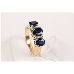 Birks 14kt yellow and white gold, three stone sapphire ring with diamond accents. Set with 1.50ct of