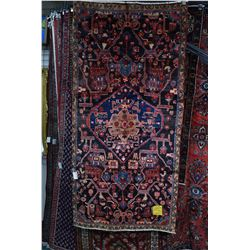 100% wool Iranian Nahavand with center medallion stylized animal figures, with dark background, acce
