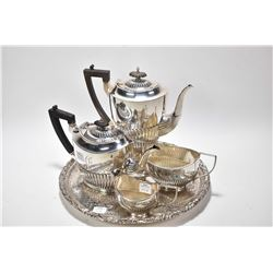 English hallmarked sterling silver coffee pot, tea pot, cream and sugar on a round silverplate tray