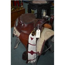 Billy Royal western show saddle with silverplate concho and decorative accents