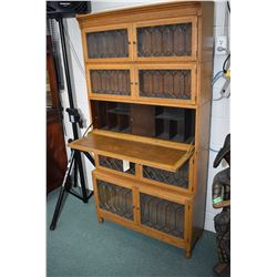 Antique oak five tier secretaire/bookcase with eight leaded glass doors and drop front writing surfa