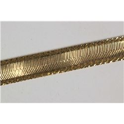 "10kt yellow gold herringbone chain with diamond cut design, 18"" in length. Retail replacement value"
