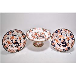 Three pieces of Imari porcelain marked Derby pattern 1721 including pedestal cake plate and two snac