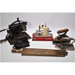 Selection of sewing collectibles including a Sew-O-Matic Senior hand crank miniature sewing machine,