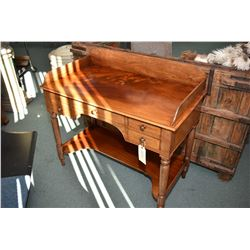 Antique flame mahogany writing desk with three drawers and under shelf