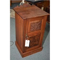 Antique mahogany single door commode with carved backboard and raised panel