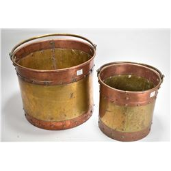 "Two antique brass and copper handled pots, 9"" and 11"" in height"