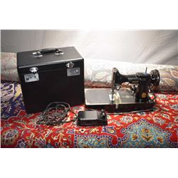 Singer Featherweight sewing machine with original case. Needs wiring repairs