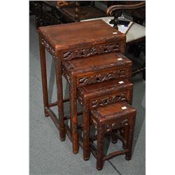 Set of four carved Oriental nesting tables with floral and leaf design
