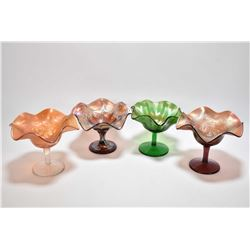 Four Carnival glass comports including a Fenton wreath of rose, a Westmoreland smooth raise green, e