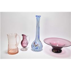 Four pieces of Altaglass including amethyst bowl, amethyst pitcher with colourless applied handle an