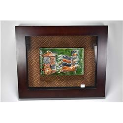 Two shadowbox framed majolica panels with one depicting mounted soldier and one depicting a four tea