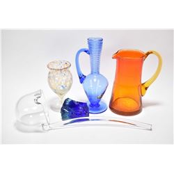 Four pieces of Altaglass including a colourless ladle with paper label, amberina pitcher, multicolou