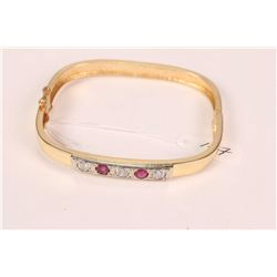 14kt yellow and white gold bracelet with three round brilliant diamonds totaling .88ct and two round
