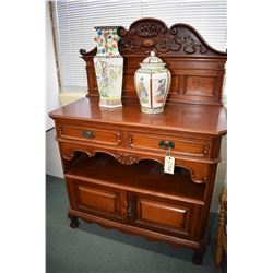 Antique mahogany sideboard/server with two drawers and two doors, and a backboard with carved ribbon