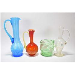 Four pieces of Altaglass including green and white jug, a white and colourless pitcher with paper la
