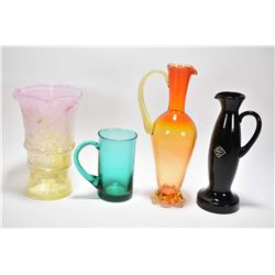 Four pieces of Altaglass including a green mug, yellow and pink vase with paper label, a amethyst pi