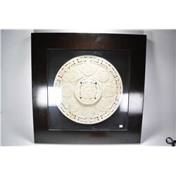 Multipanel carved stone Oriental motif circle in large shadow box display with overall dimensions 35