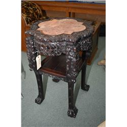 Antique Oriental rosewood table with beautifully carved skirt and top, carved ball and claw feet and
