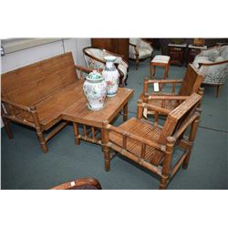 Antique four piece bamboo patio set including settee, two armchairs and a coffee table