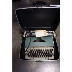TYPE WRITER IN BLACK CASE